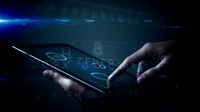 Businessman using tablet to view holographic apps video