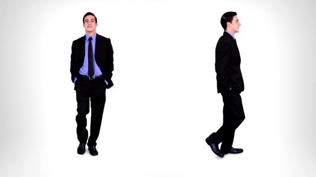 businessman walking. alpha matte. 2 in 1. - kostym sida bildbanksvideor och videomaterial från bakom kulisserna