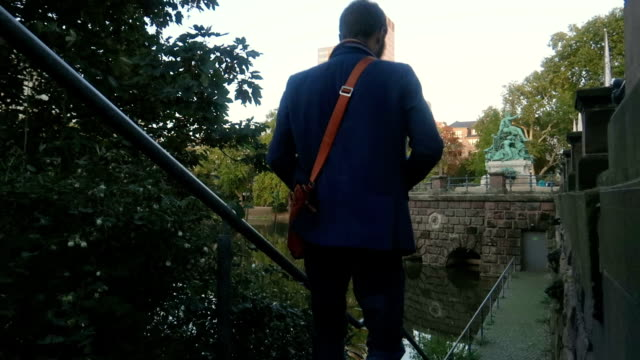 Businessman walking down stairs - Stock Video