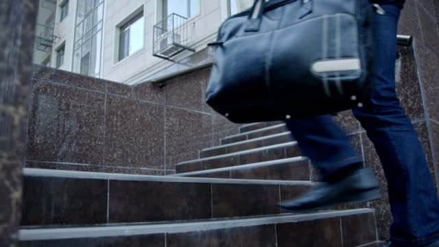 Businessman Walking Up The Stairs With His Bag video