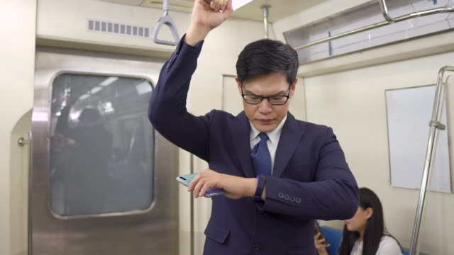 businessman watch the time in subway train while travel to work Public transportation in the city overworked stock videos & royalty-free footage