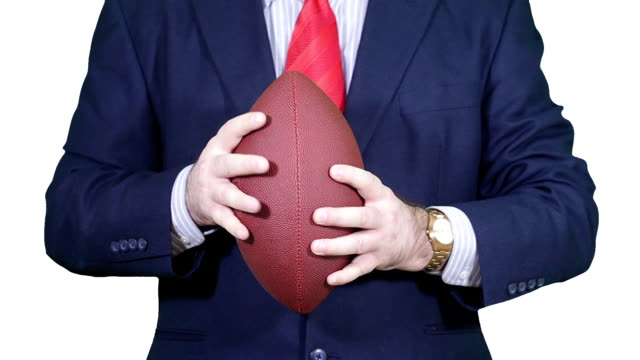 Businessman with a football. video