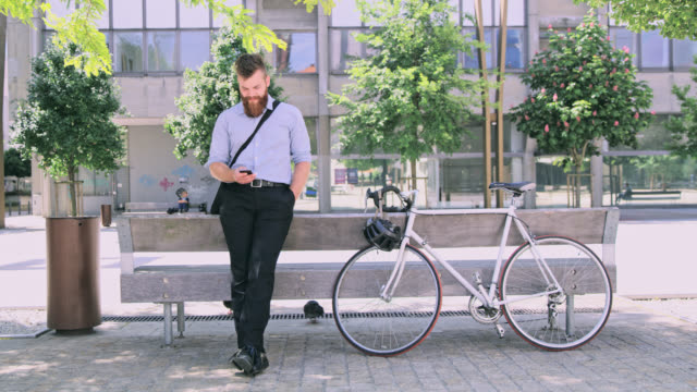 DS Businessman with beard using a smartphone in the city video