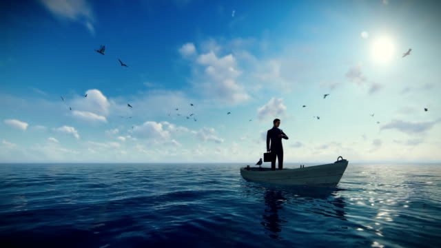 businessman with briefcase on a boat in the middle of the ocean surrounded by seagulls, drone view 4k - руководство понятия стоковые видео и кадры b-roll