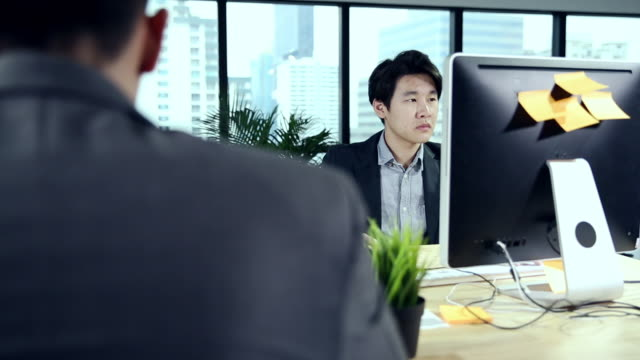 Businessman with coworker working in office