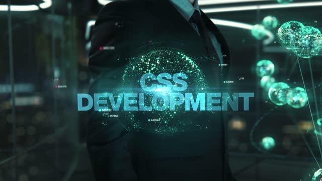 Businessman with CSS Development hologram concept