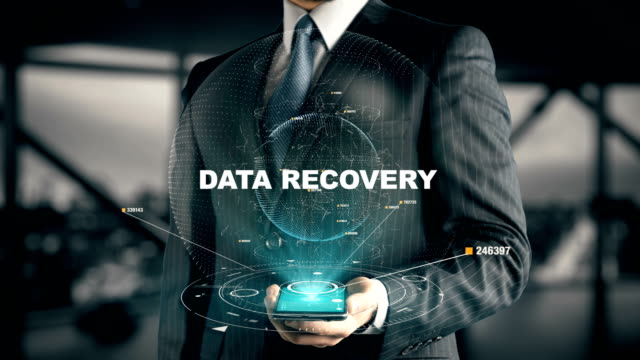 Businessman with Data Recovery Businessman with hologram in the future with futuristic smart phone with success words backup stock videos & royalty-free footage