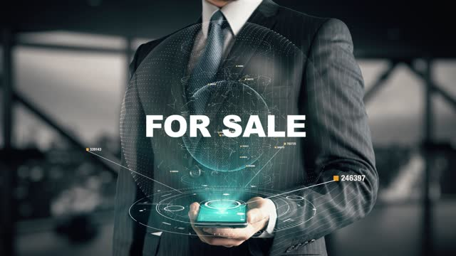Businessman with For Sale hologram concept
