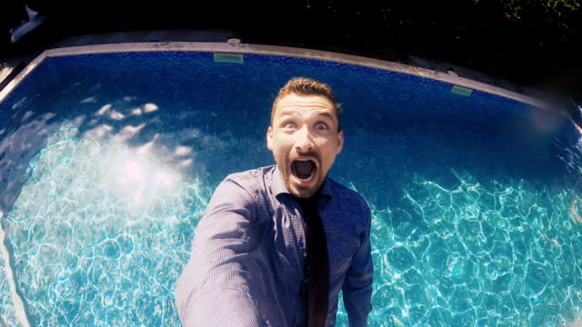 Businessman with go-pro falls in swimming pool video