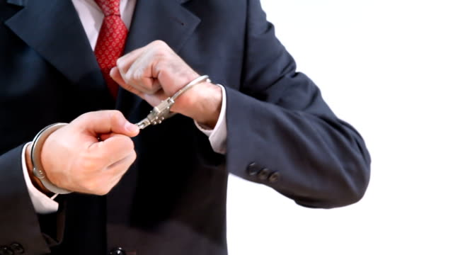Businessman with Handcuffs video