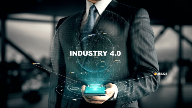 Businessman with Industry 4.0 hologram concept Businessman with hologram in the future with futuristic tablet with success words computer aided manufacturing stock videos & royalty-free footage