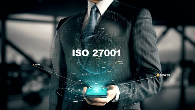 Businessman with ISO 27001 hologram concept video