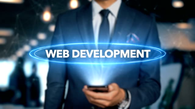 Businessman With Mobile Phone Opens Hologram HUD Interface and Touches Word - WEB DEVELOPMENT Businessman With Mobile Phone Opens Hologram HUD Interface and Touches Word - WEB DEVELOPMENT website design stock videos & royalty-free footage