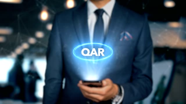 Businessman With Mobile Phone Opens Hologram HUD Interface and Touches Word - QAR video