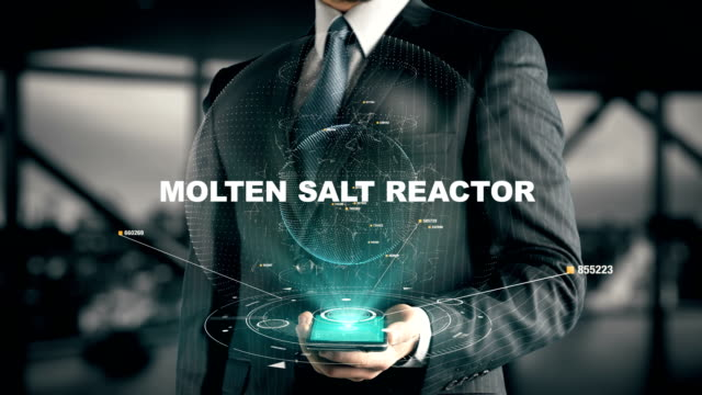 businessman with molten salt reactor hologram concept - reattore nucleare video stock e b–roll