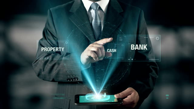 Businessman with Reliability concept choose Bank from Property Cash using digital tablet video