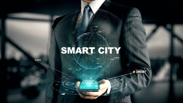 geschäftsmann mit smart city - smart city stock-videos und b-roll-filmmaterial