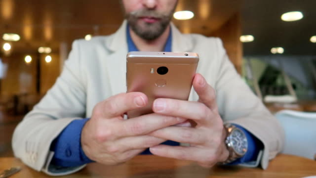 Businessman with smartphone - Stock Video