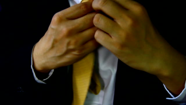 businessman with suit hand hold  set up necktie ,dressed up video
