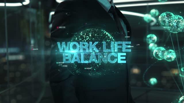Businessman with Work Life Balance hologram concept