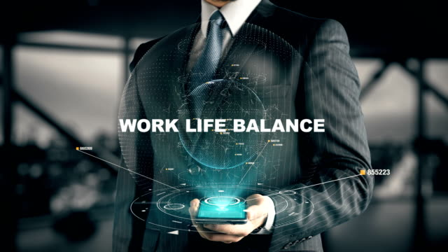Businessman with Work Life Balance Businessman with hologram in the future with futuristic smart phone with success words life balance stock videos & royalty-free footage