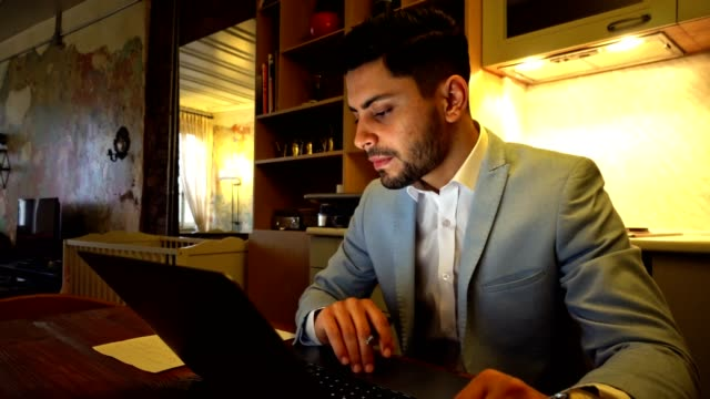 businessman working at home with laptop - owner laptop smartphone video stock e b–roll