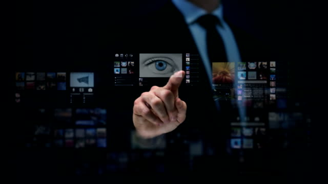 Businessman working on a futuristic holographic interface. Touchscreen. Eye-tunnel. video