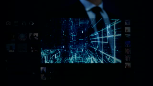 Businessman working on a futuristic holographic interface. Touchscreen. Eye-circuit board. video