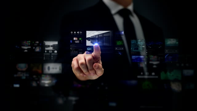 Businessman working on a futuristic holographic interface. Touchscreen. Servers. video