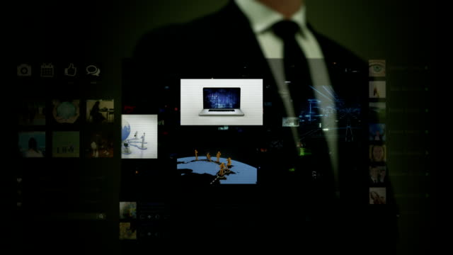 Businessman working on a futuristic holographic interface. Video wall.