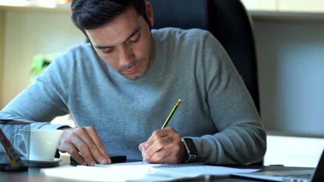 businessman working on desk at home