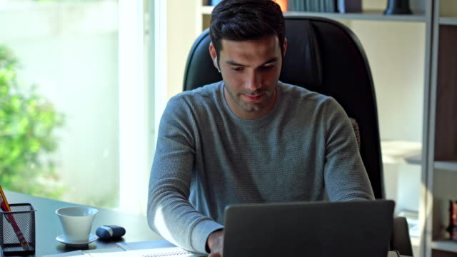 businessman working on desk at home