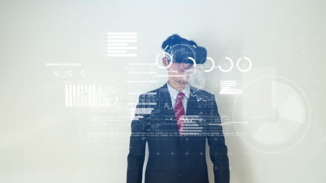 Businessman working on financial data with virtual reality headset video