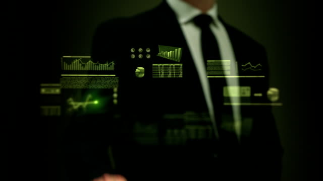 Businessman working on holographic interface. Financial. Green. video