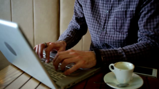 Businessman working on laptop at cafe video