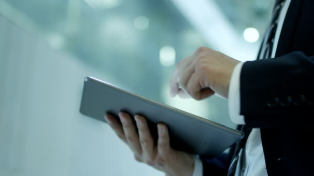 Businessman Working on Tablet in Office video
