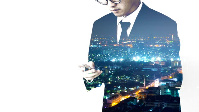 Businessman working with smart phone and time lapse background video