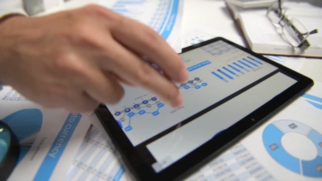 Businessman working with tablet pc, calculating, reading and writing reports. Office employee, table closeup. Business financial accounting concept. Businessman working with tablet pc, calculating, reading and writing reports. Office employee, table closeup. Business financial accounting concept. accounting stock videos & royalty-free footage