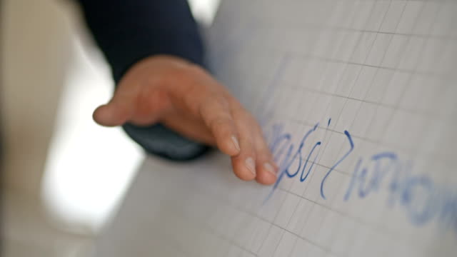 Businessman write information at plastic white board in modern office building video