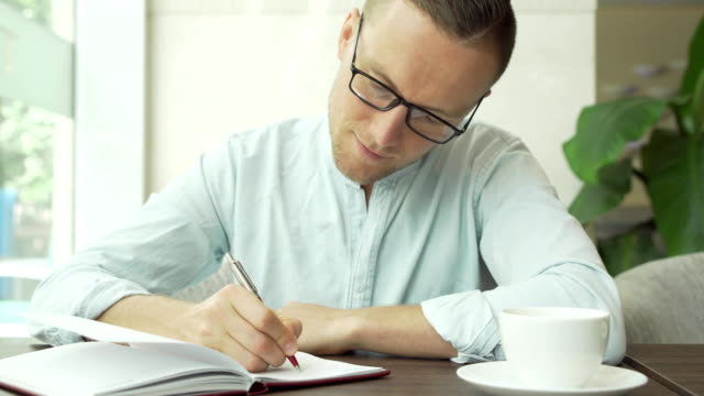 businessman writing a to do list in a business planner - to do list video stock e b–roll