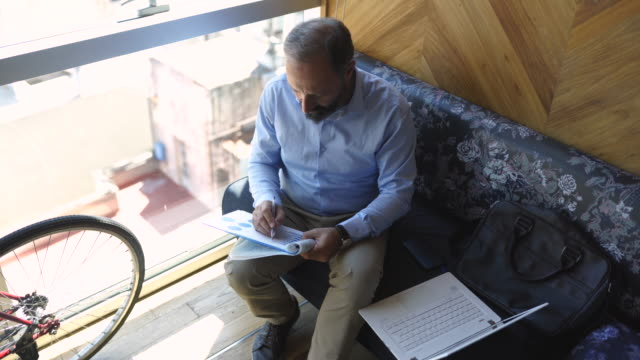 Businessman writing business plan on the paper at work