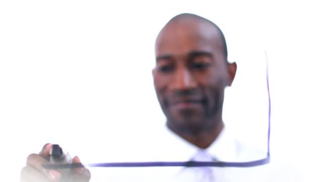 Businessman writing data on glass video