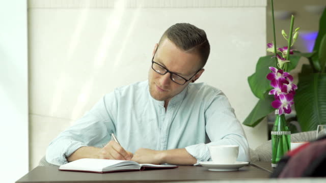 Businessman writing in the personal organizer video