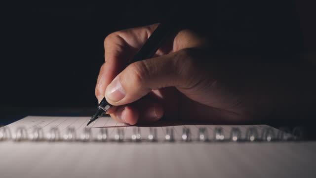 Businessman writing notebook on night