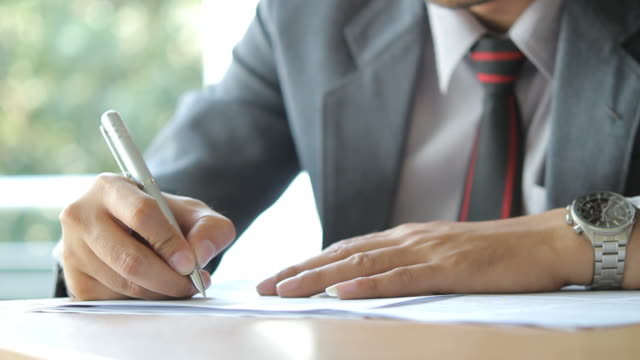 HD : Businessman writing on document video