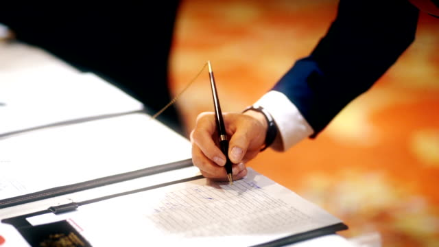 Businessman Writing on the Table : Registration Concept. video