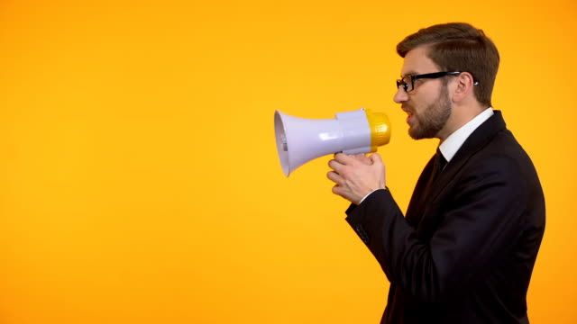 Businessman yelling in megaphone, announcement of breaking news, place for text Businessman yelling in megaphone, announcement of breaking news, place for text megaphone stock videos & royalty-free footage