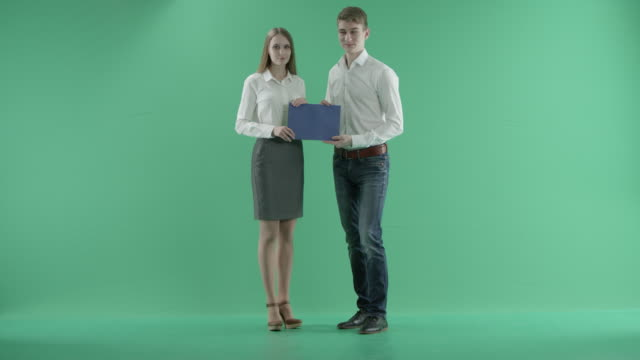 businessmen and blue card n a green screen - travel agent stock videos and b-roll footage