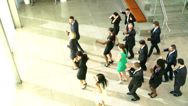 Businessmen And Businesswomen Dancing In Office Lobby video