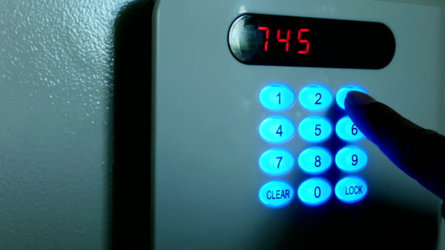 Businessmen are pressing the security lock code. video